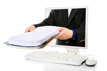 A businessman is holding the document from inside computer's screen.